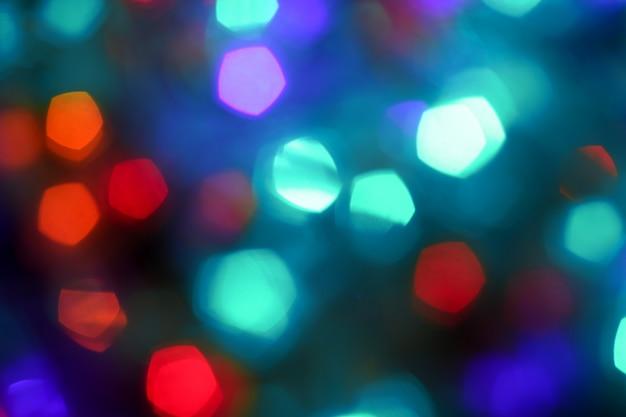 Bokeh festivo fundo de natal, pano de fundo azul brilhante para férias