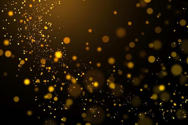 Bokeh luz dourada e abstrato brilhante sobre fundo escuro.