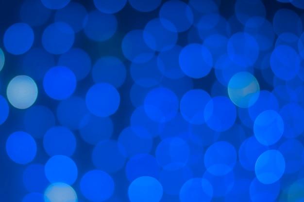 Bokeh redondo vibrante bonito no azul clássico