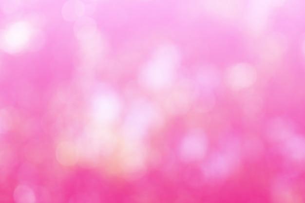 Bokeh rosa bonito fora de fundo de foco da árvore na natureza, arte abstrata