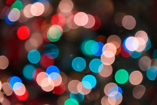 Bokeh vívido no estilo de cor suave para o fundo da luz de natal