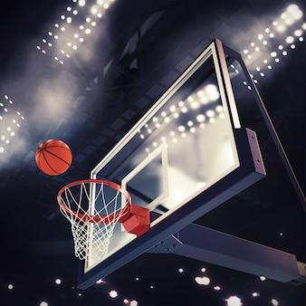 Bola acima da cesta durante o jogo de basquete