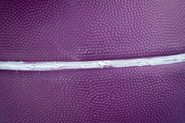 Bola de basquete roxo com linhas brancas