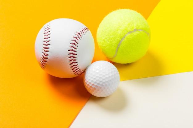 Bola de beisebol, tênis e golfe
