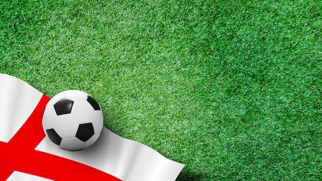 Bola de futebol com bandeira de inglaterra na grama verde no estádio com espaço de cópia