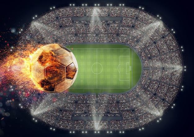Bola de futebol com chamas de fogo sobre um estádio