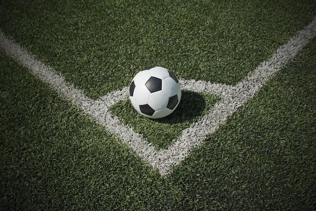 Bola de futebol no campo da esquina