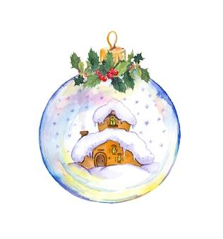 Bola de neve de natal com pequena casa