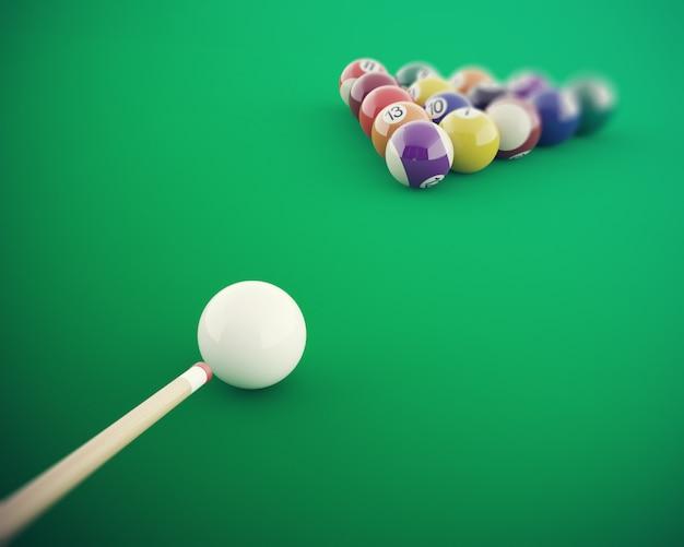 Bolas de bilhar antes de bater em uma mesa de bilhar verde.