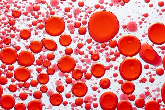 Bolha de óleo de fundo abstrato vermelho em papel de parede de água