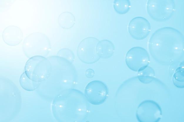 Bolhas de sabão azuis flutuam fundo