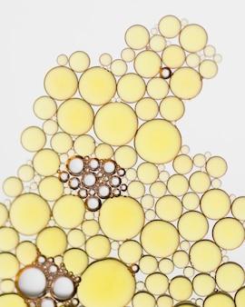 Bolhas douradas abstratas do close-up