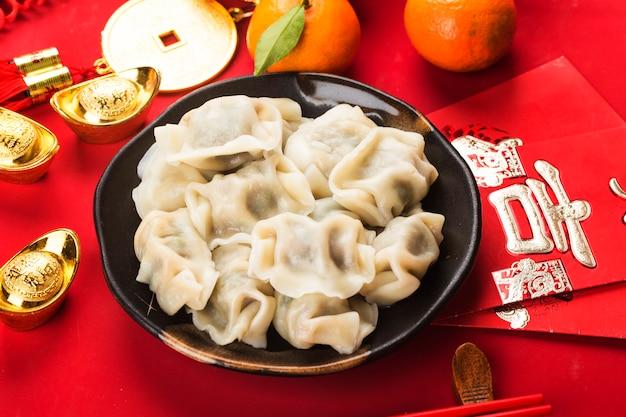 Bolinhos de massa para o festival da primavera chinês chinês grande sorte