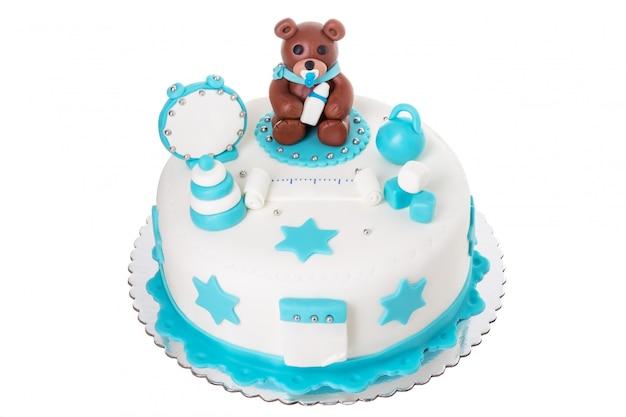 Bolo criativo para um menino recém-nascido. com um urso.