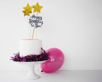 Bolo e balão decorados