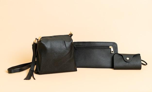 Bolsa de mão de couro preto e bolsa de couro preta para cartão