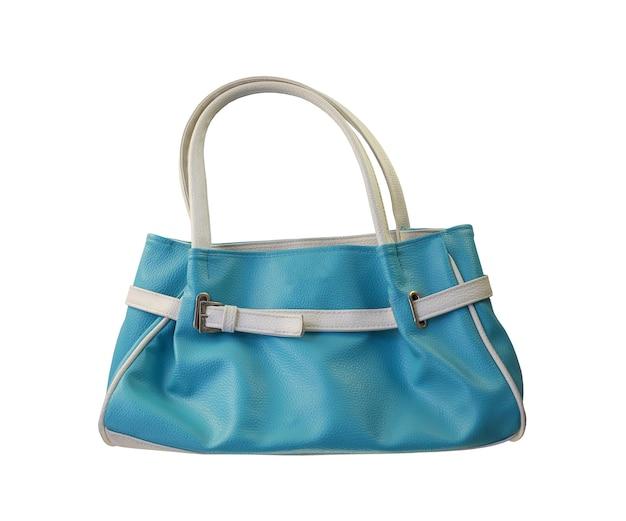 Bolsa de moda azul isolada no fundo branco e tem traçados de recorte.