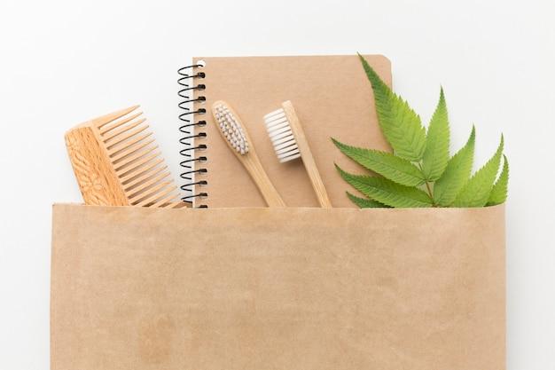 Bolsa ecológica com caderno e pente