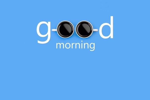 Bom dia, palavra com duas xícaras de café em qualquer lugar sobre fundo azul