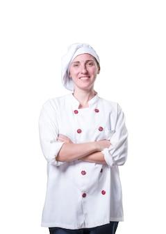 Bom jovem chef com utensílios de madeira