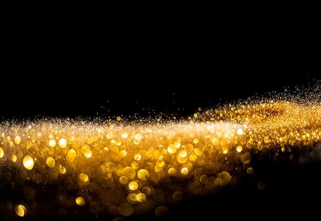 Bombas de purpurina turva, purpurina dourada fundo abstrato do grunge das luzes cintilantes desfocado.