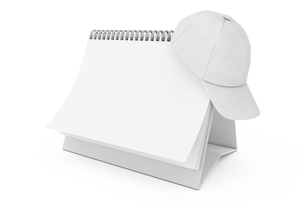 Boné de beisebol em branco da moda branco sobre o calendário de espiral de mesa de papel em branco sobre um fundo branco. renderização 3d