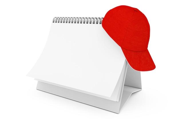 Boné de beisebol em branco da moda vermelho sobre o calendário de espiral de mesa de papel em branco sobre um fundo branco. renderização 3d