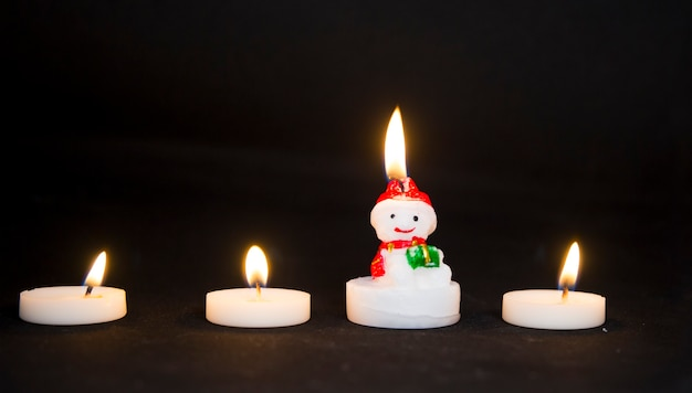 Bonecos de neve de velas de natal