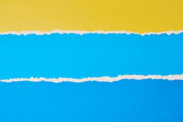 Borda de papel rasgado e rasgado com espaço de cópia, cor azul e amarelo
