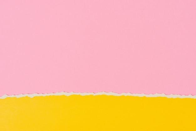Borda de papel rasgado rasgado em rosa e amarelo