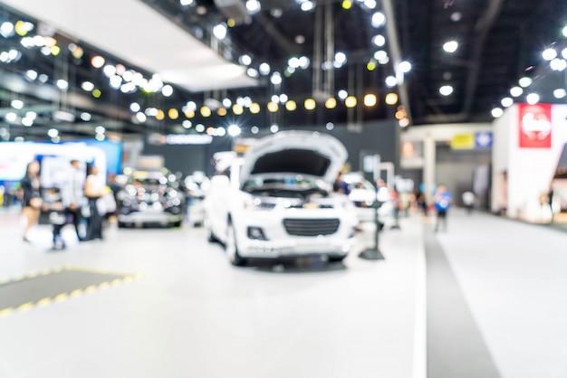 Borrão abstrata e carro desfocado e evento de exposição de exposição de motor