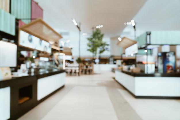 Borrão abstrata e centro de tribunal de comida desfocado em shopping