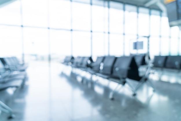 Borrão abstrata e interior terminal do aeroporto desfocado