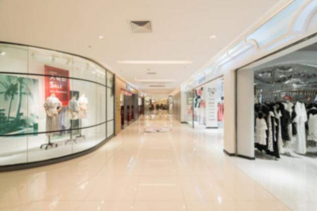 Borrão abstrata e shopping desfocado no interior da loja de departamento