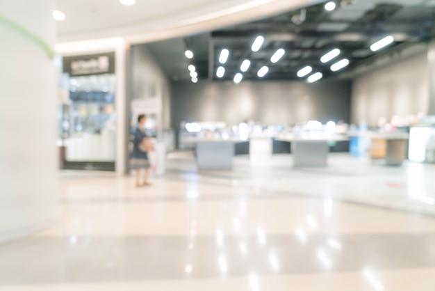 Borrão abstrata no shopping de luxo e loja de varejo