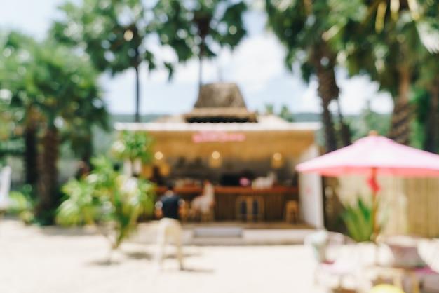 Borrão abstrato café café e restaurante na praia