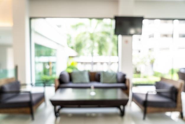 Borrão abstrato e átrio desfocado no interior do hotel