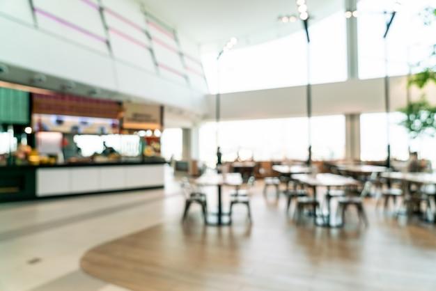 Borrão abstrato e centro de tribunal de comida desfocado em shopping