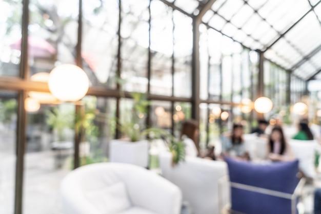 Borrão abstrato e desfocado no restaurante café para o fundo