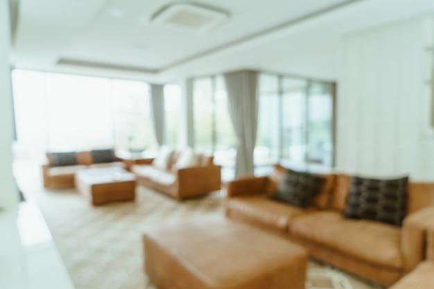 Borrão abstrato e interior da sala de estar desfocado