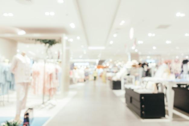 Borrão abstrato e shopping desfocado em loja de departamento