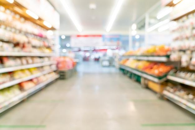 Borrão abstrato e supermercado desfocado