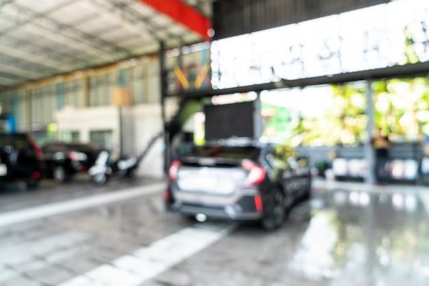 Borrão abstrato lavagem de carro no cuidado do carro