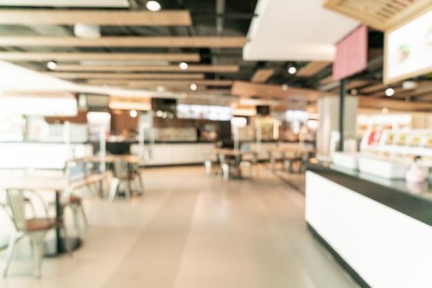 Borrão abstrato praça de alimentação em shopping