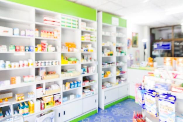Borrão prateleiras de drogas na farmácia