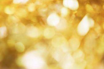 Borre o fundo da luz do bokeh da cor do ouro, popular no festival geral.