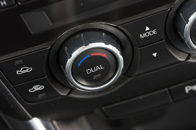 Botão de climatização para automóvel com ajuste duplo