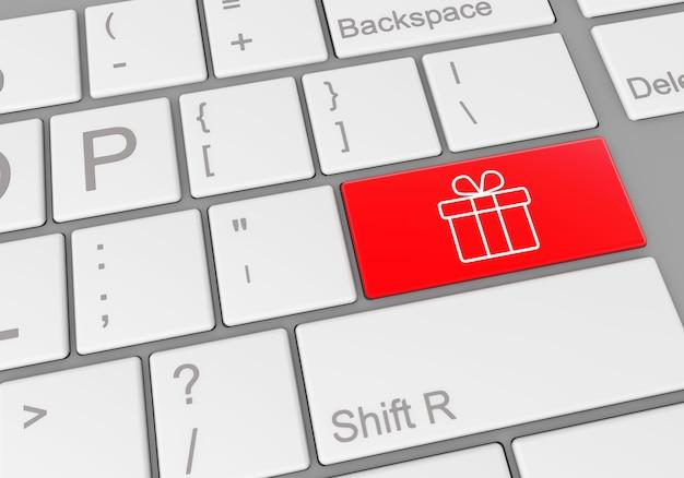 Botão especial com uma caixa de presente em um teclado de laptop