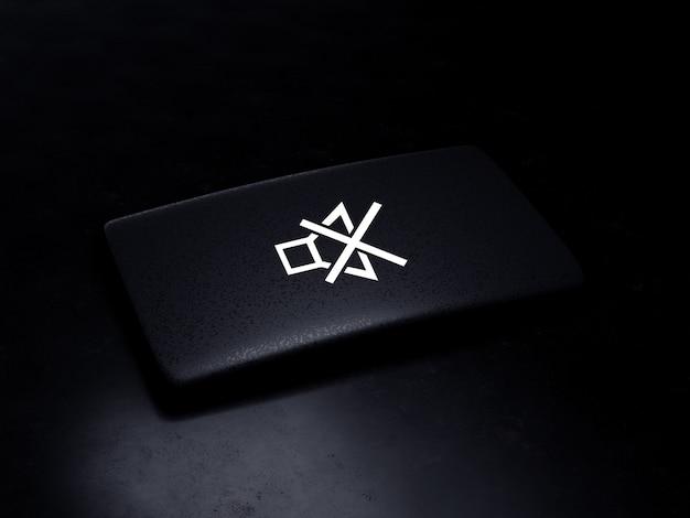 Botão mudo preto na superfície escura, render 3d