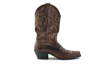 Botas de cowboy, à beira